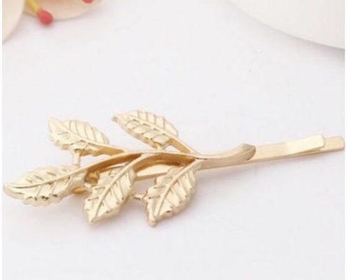 clips dorados con hojas