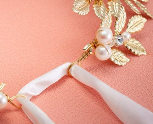 close up of back bridal hair accesory delicate leaves pearl incrusted