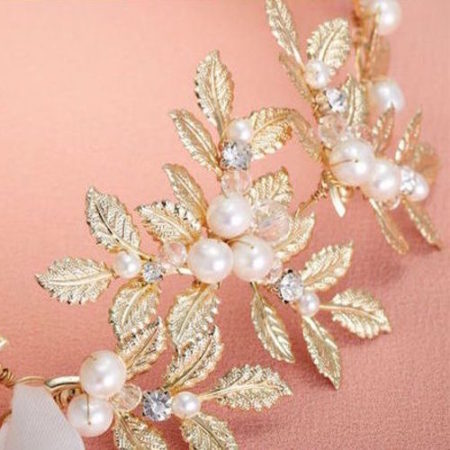 detail of bridal hair accesory delicate leaves pearl incrusted