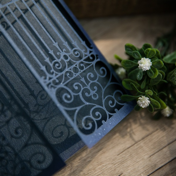 Laser cut gate fold wedding invitations in navy blue.