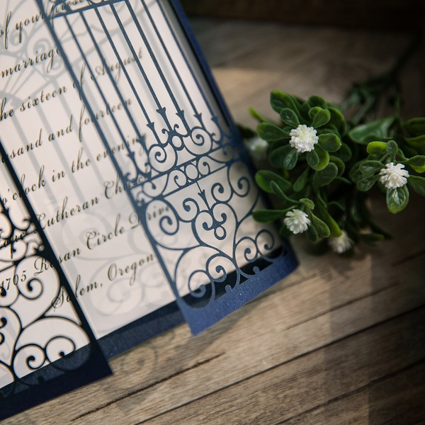 Gate fold wedding invite in navy blue.