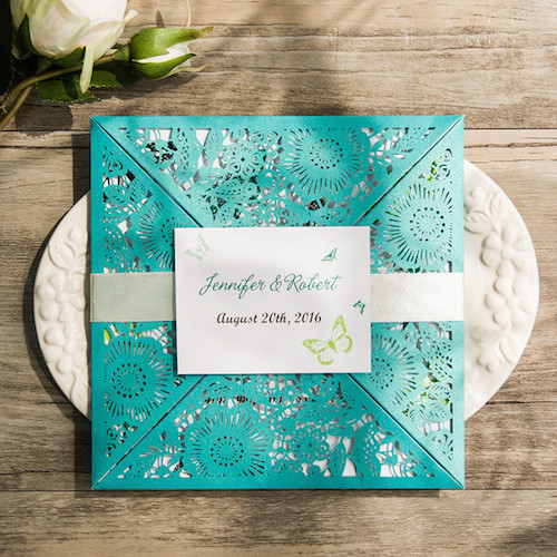 Perfection in laser cut teal wedding invitations.