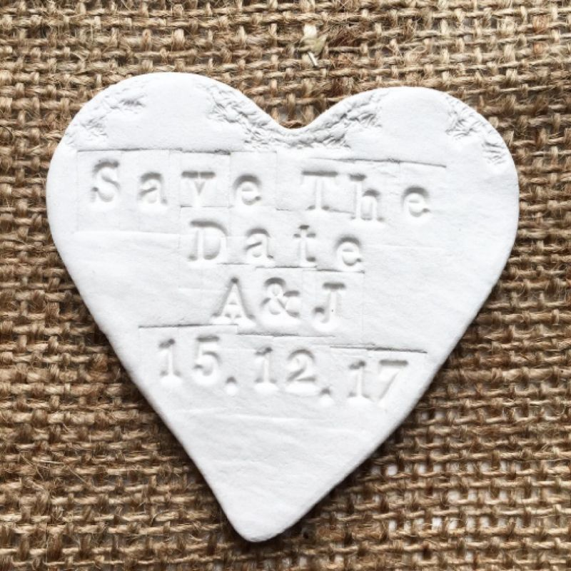 White heart save the date magnet.
